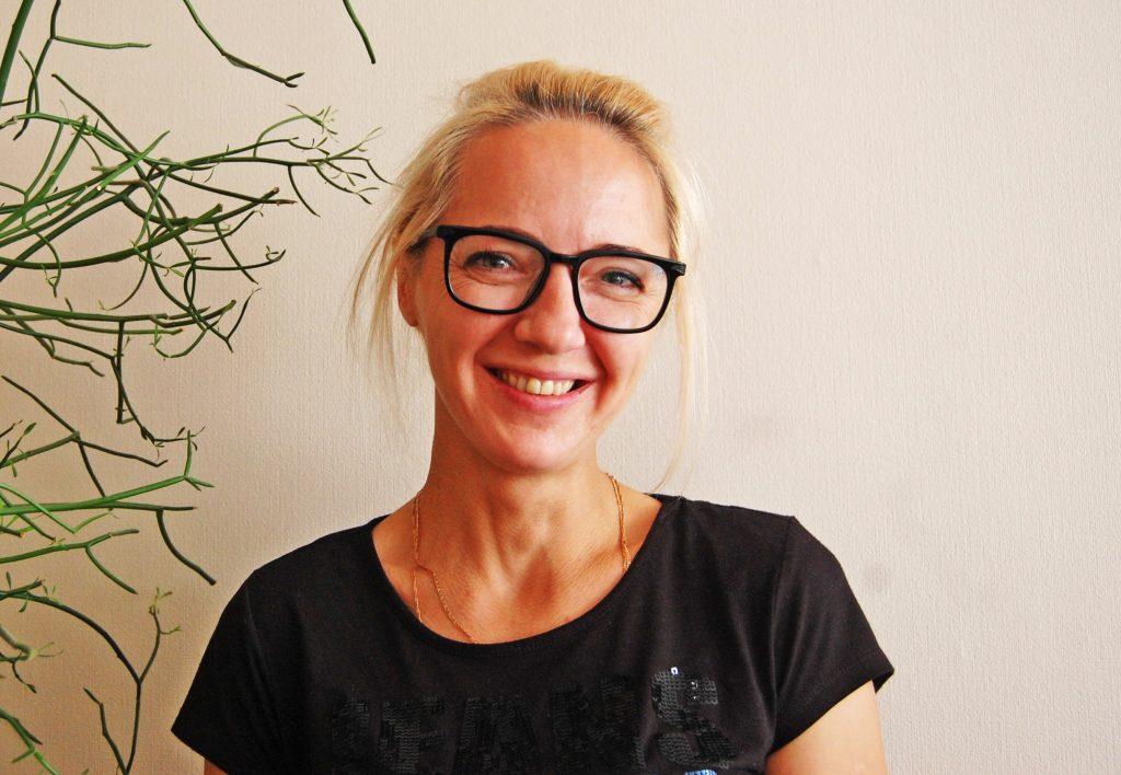Renata Palubinskienė džiaugiasi, kad dar bent pusę metų Savivaldybei mokės nepadidintą būsto nuomos mokestį. Autorės nuotr.