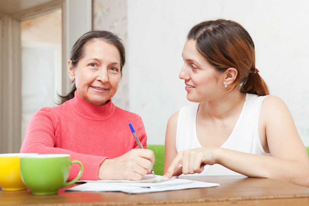 Adult,Daughter,With,Mother,Fills,In,The,Questionnaire,At,Home